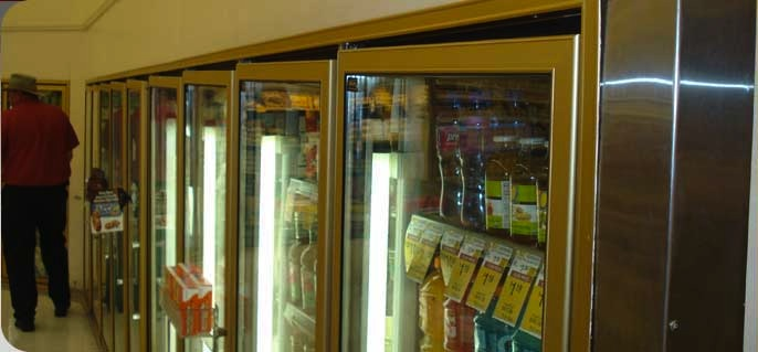 This shopping center had settled up to 12 inches which caused severe racking of the cooler doors.