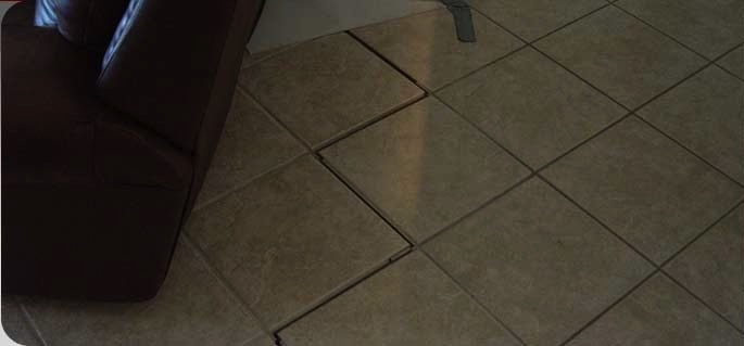 Soil movement can crack the interior floor slab and reflect through floor tile.